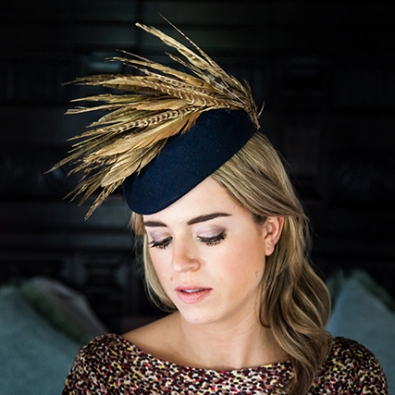 Base in navy, feathers natural with gold dusting