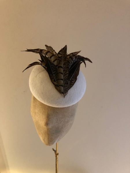 Ivory base with pheasant feathers